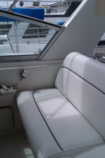 reinforced the seat with stainless steel L-brackets and designed fitted, comfortable cushions in white with gray piping.